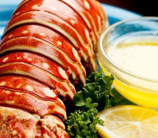 Lobster tail served with clarified butter and a slice of lemon