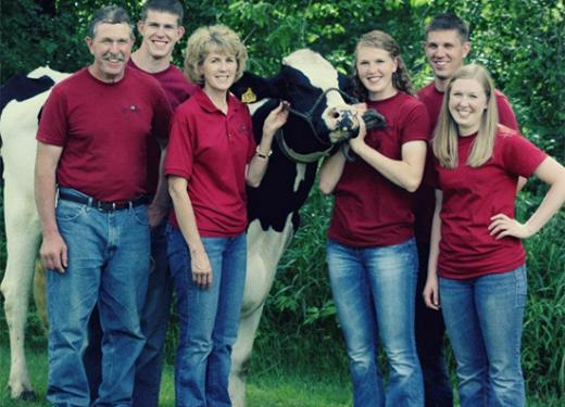 The Daninger family with one of their Autumnwood Farm cows