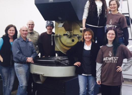 The Hayward Coffee Co. in front of their commercial-size coffee roaster