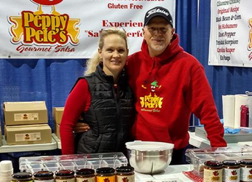 Lisa and Dave Jacobson, founders of Peppy Pete's Gourmet Salsa, selling salsa from their fair booth