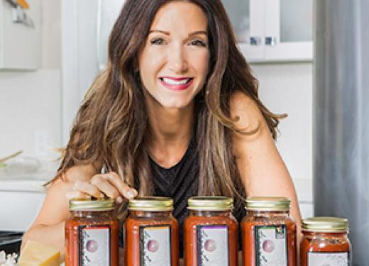 Sause Anna Lisa founder Lisa O'Connell posing behind jars of her pasta sauce