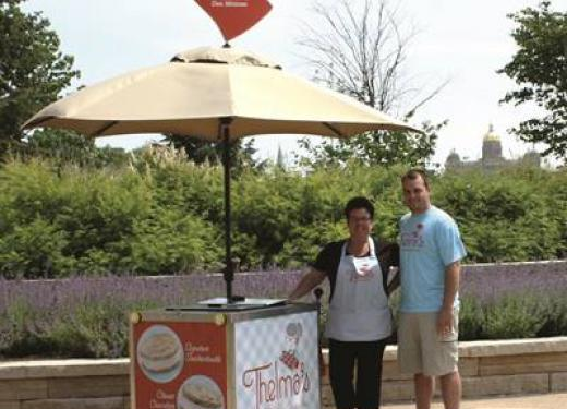 Dereck and Lana Lewis selling Thelma's Ice Cream Sandwiches from their little pushcart