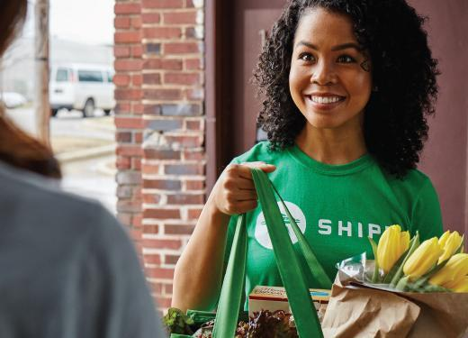 Shipt shopper delivering groceries to a customer's door
