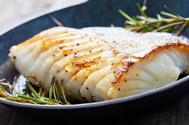 Fillet of baked cod garnished with rosemary