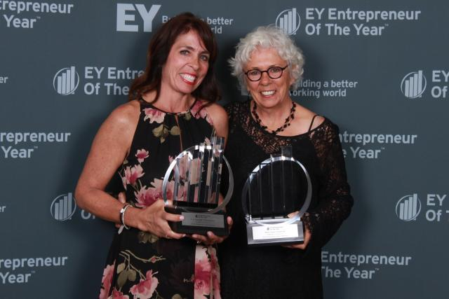 Kowalski's and Mary Anne Kowalski holding EY Entrepreneur of the Year trophies
