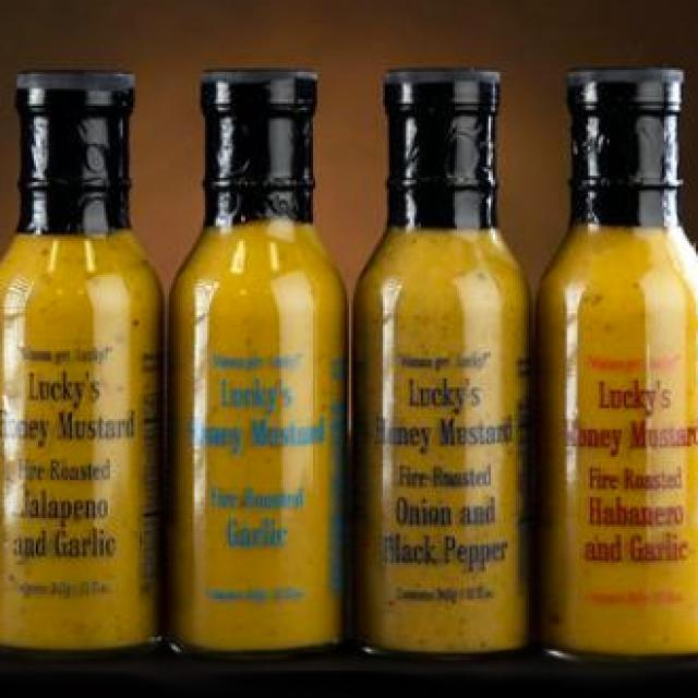 Four bottles of Lucky's Honey Mustard