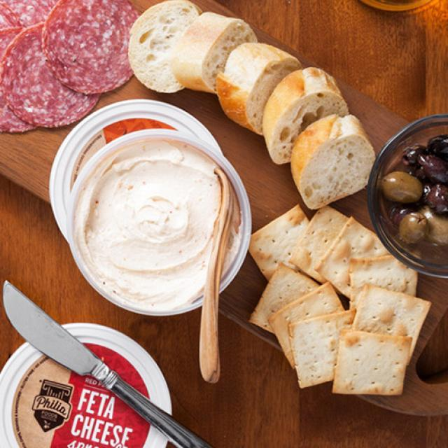 Philia Feta Cheese Spreads served with crackers, sliced ciabatta, salami and olives