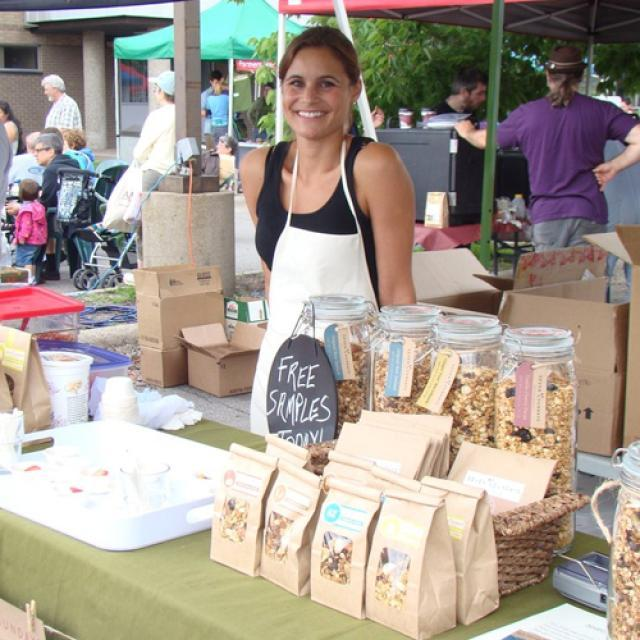 Hannah Barnstable selling Seven Sundays Muesli at a farmers market
