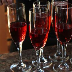 Champagne Glasses with Red Drink